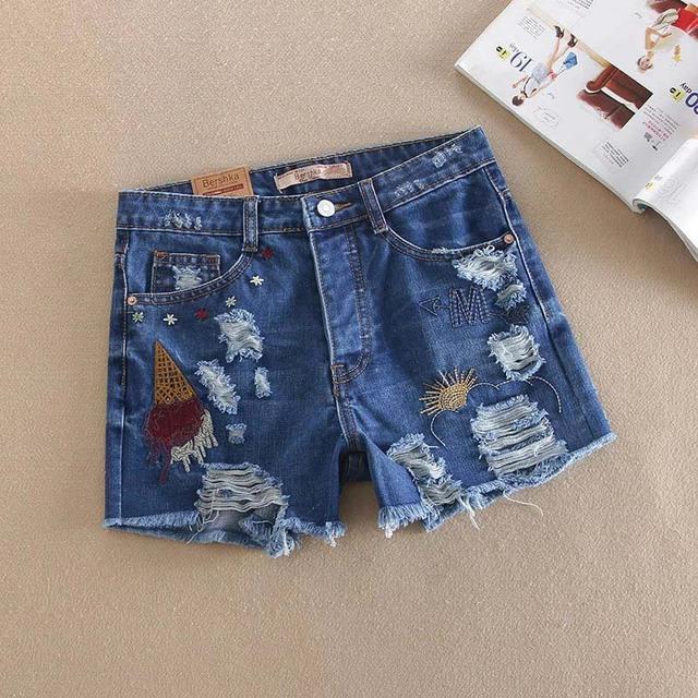 2016 verano nuevo estilo Europeo de la calle marea párrafo agujero pantalones cortos de mezclilla bordados, salvajes pantalones cortos de mezclilla de flash hembra tapeta con botones