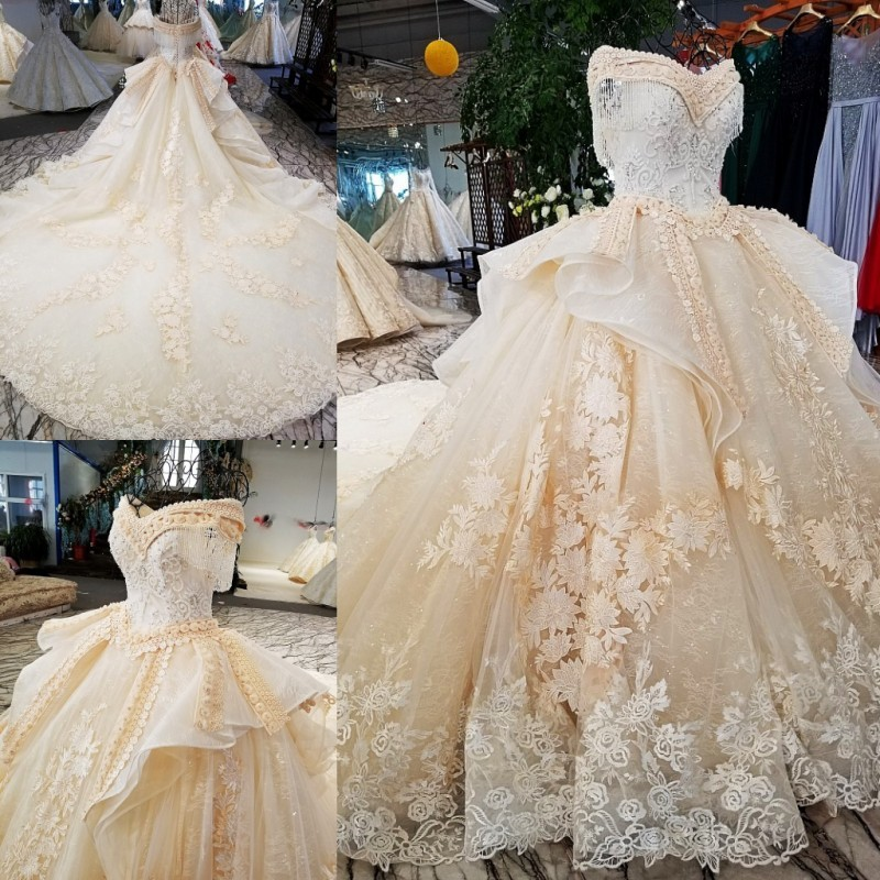 Nhampagne color lace real pictures show asymmetric two layers design off shoulder lace up back wholesale wedding dress 2018