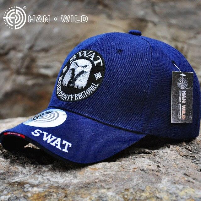 HAN WILD genuino marca azul marino gorras de béisbol del ejército bordado  águila cabeza creativo para ee922581c12