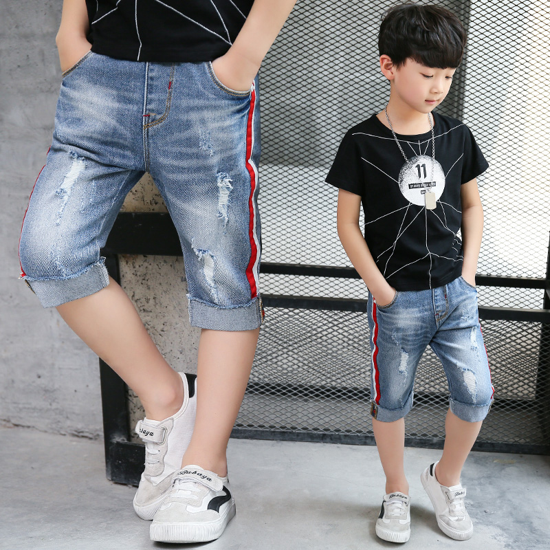 teen-boy-ripped-jeans-young-black-man