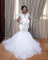 2018 African Mermaid Trumpet Wedding Dress Boat Neck Lace Appliques Long Illusion Sleeves Court Train Tiered Tulle Bridal Gown