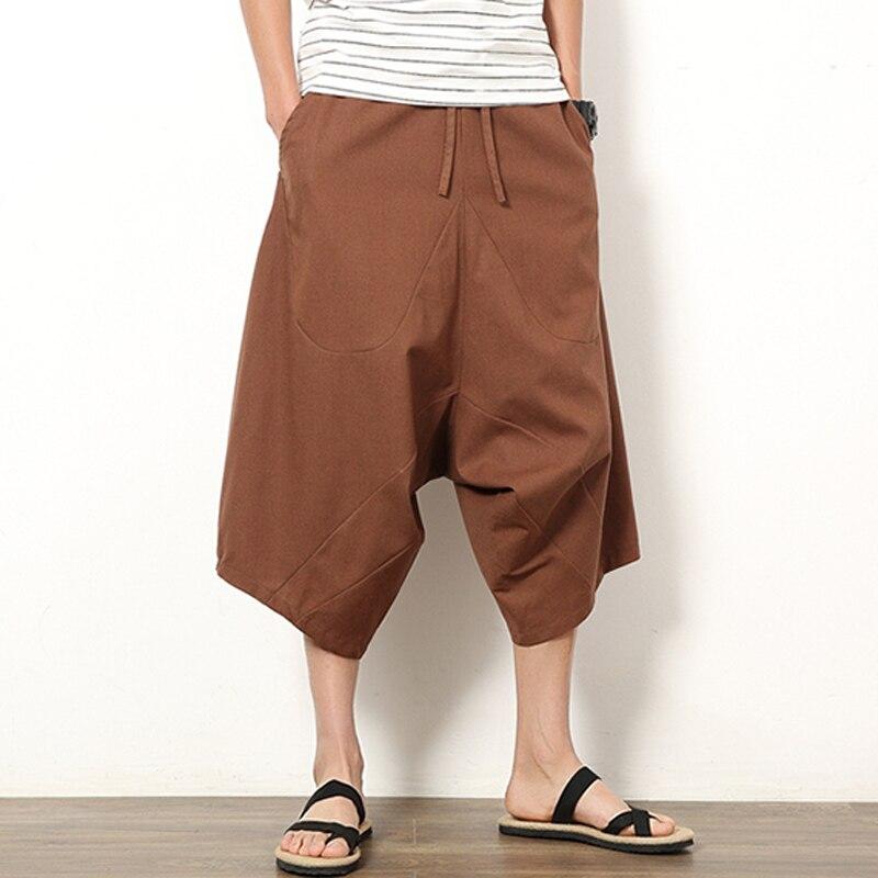 Sznurkiem wysokie do talii elastyczne szorty męskie luźne Harem Bloomers nogi duży rozmiar 5XL plaża bermudy letnie spodnie dresowe czarny Hip Hop w stylu Vintage