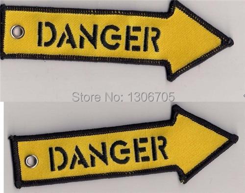 Опасность стрелка ткань брелок