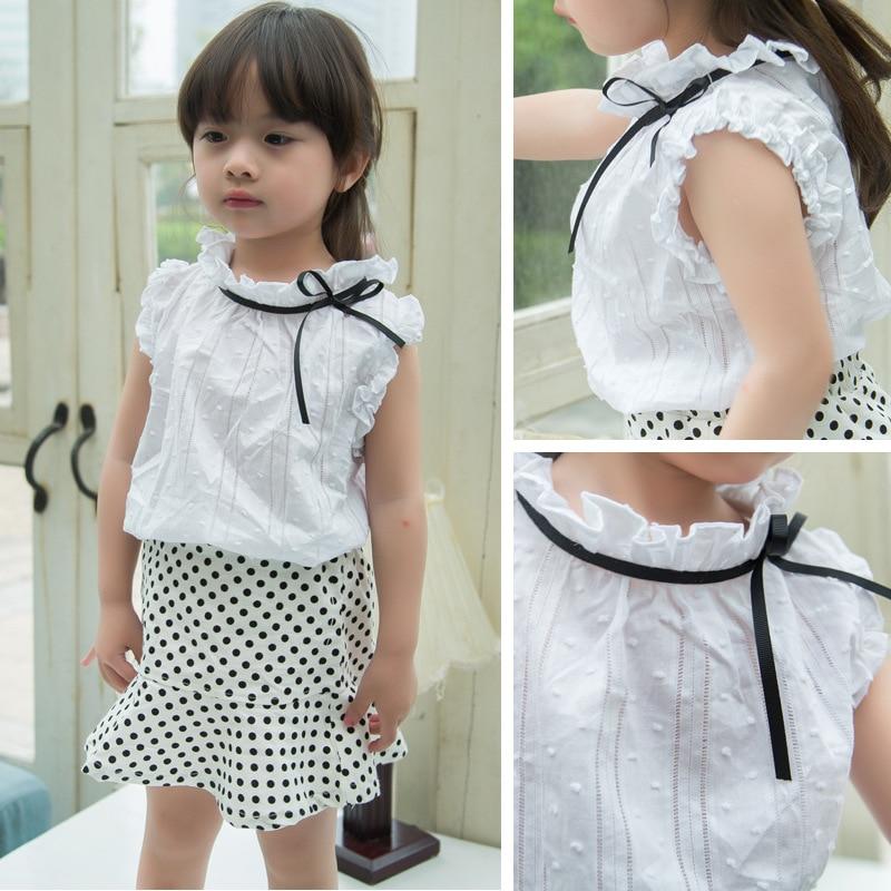 4efd364e7 Señoras cupieron la camisa elegante para niño pequeño pequeña escuela de  los niños niñas blusa blanca collar de la colmena del verano del estilo  coreano ...
