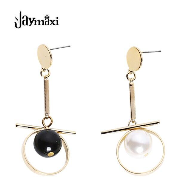 Boucle d'oreille or blanc perle noire
