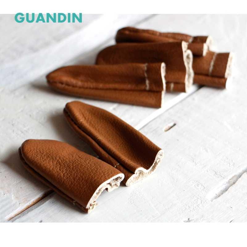 GUANDIN ، 1 زوج/الوحدة ، بيع لون عشوائي ، ورأى لتقوم بها بنفسك اليدوية غطاء جلد الاصبع ، الصوف التلبيد مدسوس إبرة أداة لحماية الاصبع