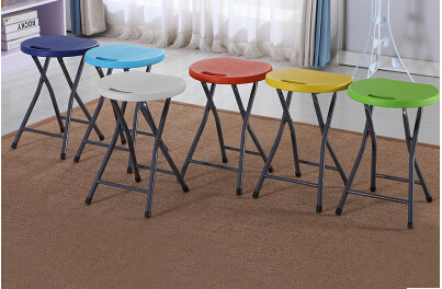 Household folding stool. A portable chair. Adult small wooden bench outdoor fishing camp stool. Military plastic stool