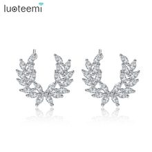 LUOTEEMI Fashion Feather Stud Earrings for Women Wedding Party Jewelry Angle Wing CZ Stone Earrings Leaf Brincos Christmas Gifts(China)