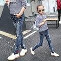 Niños Jeans Skinny Jeans Baby Girl Otoño Invierno Pantalón Largo Button Fly Moda Denim pantalones Vaqueros de Los Niños Para Las Niñas