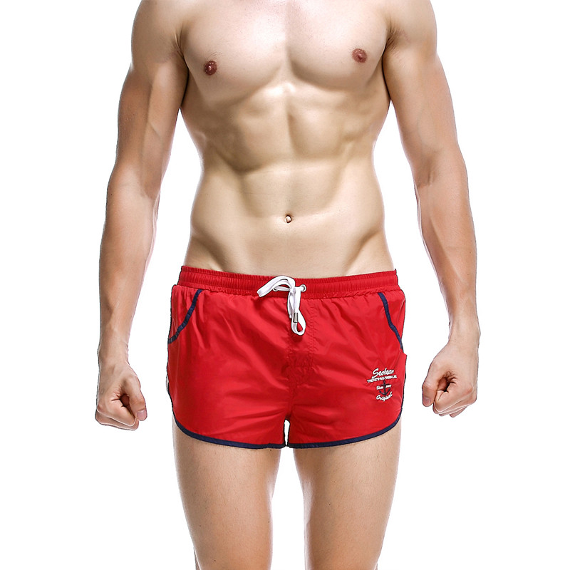 Pantalones cortos casuales de los nuevos hombres de SEOBEAN capris líquido lino del color del caramelo hasta la rodilla cortos elásticos 3 colores