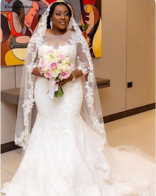 Фото свадебное платье с длинным рукавом аппликацией и жемчугом