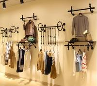 Clothes hangers for men and women's clothing. Display rack. Hang on wall. Display shelves1103