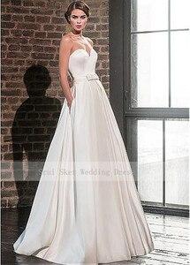 Image 2 - אלגנטי מתוקה סאטן חתונת שמלה עם מעיל ארוך שרוול באורך רצפת כלה שמלות כיסים Robe De Mariage