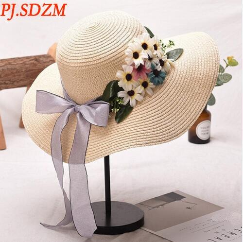 Chapeau d'été en paille avec fleur ...