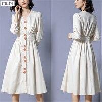 the dress OLN Koreanvestidos new women's three dimensional buckle feminine slim waist temperament over the knee V neck dress U01