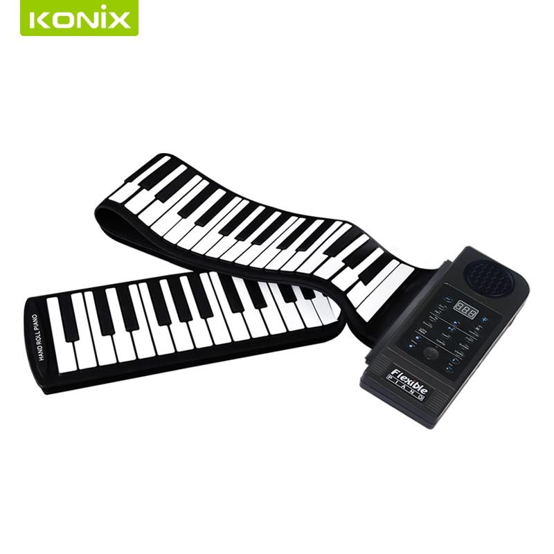 дечији електронски клавир за играчке са мини клавирском тастатуром омотан лаптоп рачунаром и Апп