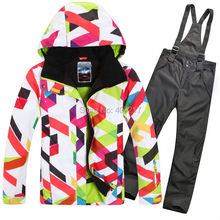 2015 hot womens ski suit female outdoor windproof sportswear suit skiwear colorful curves jacket and black suspender ski pants