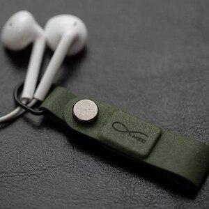 Image 5 - חם מקורי Bcase MEC מגנטי אוזניות קליפ שלושה צבעים עור אבזם אוזניות חוט ארגונית מחזיק נייד כבל