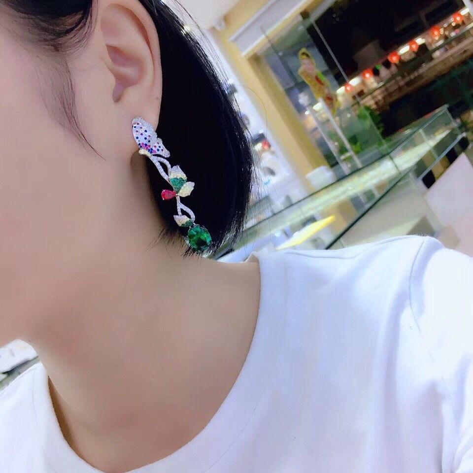 Qi xuan_joaille_nouvelles boucles d'oreilles papillon boucles d'oreilles S925 argent incrusté Zircon élégant et irrégulier irrégulier _ ventes directes d'usine