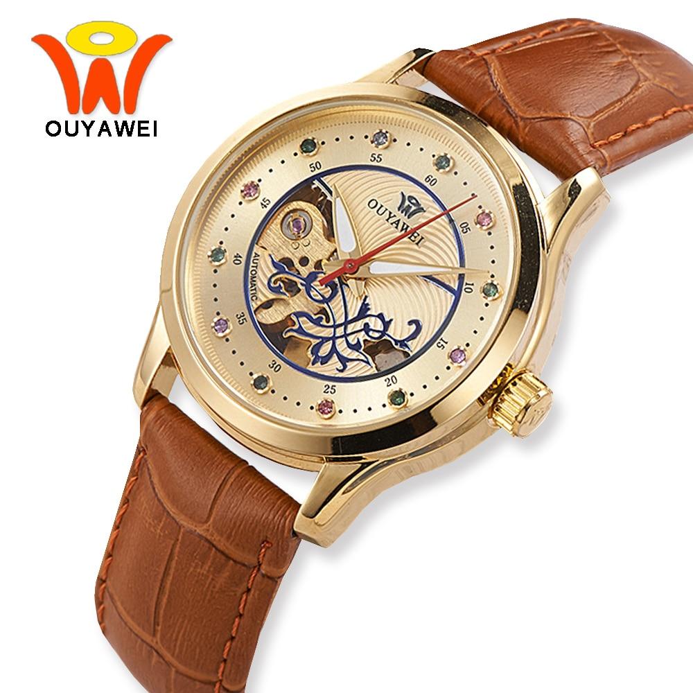 Πολυτελή χρυσό σκελετό Αυτόματο ρολόι γυναικών ρολογιών OUYAWEI Fashion Mechanical Ρολόγια χεριού Διαφανή Δερμάτινο ρολόι montre femme