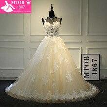 เส้นภาษาฝรั่งเศสคำชุดแต่งงานลูกไม้กับเข็มขัดที่ถอดออกได้แชมเปญ Robe De Mariage Vestido De Noiva Milla nova MTOB1703