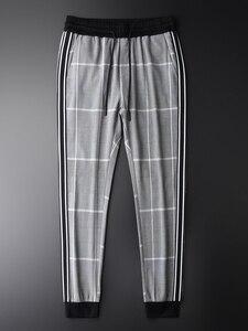Image 1 - Minglu xadrez calças homem cintura elástica de luxo fino ajuste tornozelo comprimento calças plus size 4xl fios tingidos cheques moda masculina calças casuais