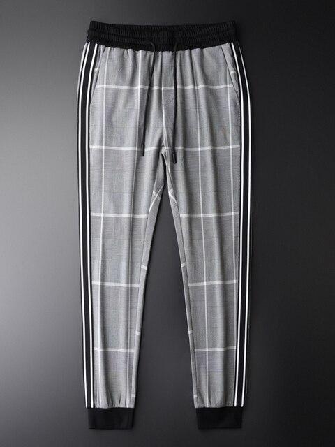 Minglu xadrez calças homem cintura elástica de luxo fino ajuste tornozelo comprimento calças plus size 4xl fios tingidos cheques moda masculina calças casuais