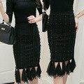 new Korean winter women's vertical stripes nail bead irregular hem long bag hip skirt tassel hem