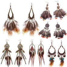 Купить с кэшбэком Variety Bohemian long brown feather earrings for women Fashion Ethnic dangle earing 2019 New Trendy Boho Ear Jewelry Accessories