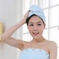 A fibra de bambu toalha absorvente cabelo seco uso de bambu com roupão de banho