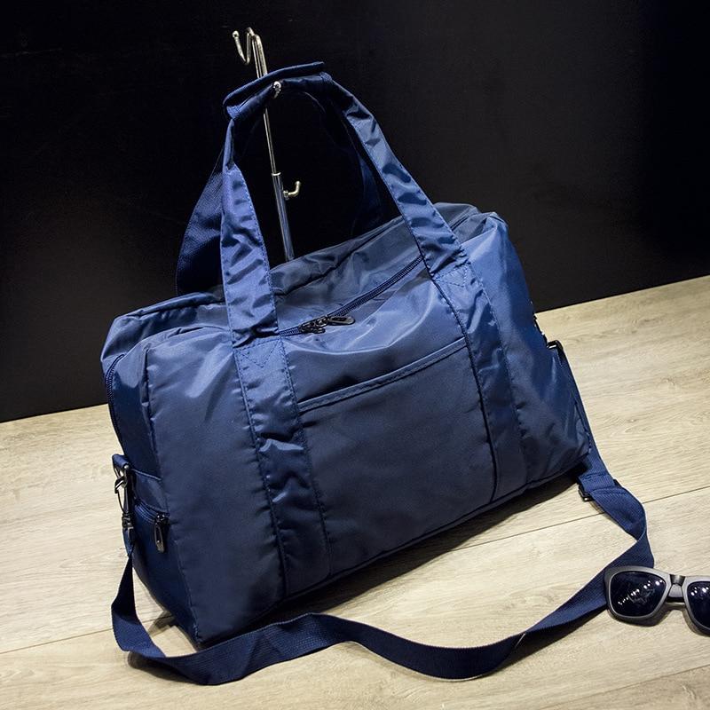 Bolsa de gimnasio de mano impermeable de nailon plegable 36 55L bolsa de  deporte de gran capacidad de Color sólido bolsa de viaje para hombre bolsa  de fin ... 8580782d3c8a3