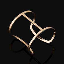 DILILI 2017 new fashion womens clothing accessories Golden plated hollow out alloy unique simple wide  cuff bangle xsb499