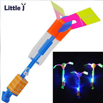 12Pcs/Lot Amazing LED Light Arrow Rocket Helicopter Rotating Flying Toys Party Fun Kids Outdoor Flashing Toy Fly Arrow 1
