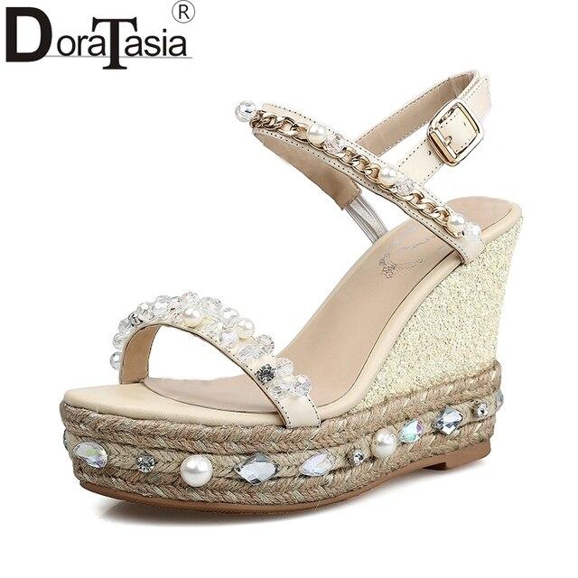 3852bf3a76176 DoraTasia véritable en cuir peals ruban rose marque femme chaussures wedge talon  haut gladiateur sanda de