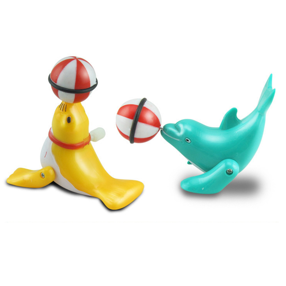 Childrens Wind-up Toy Dolphin Top Ball 360 Degree Rotation Fun Dolphin Modelling Circus Clockwork Toy