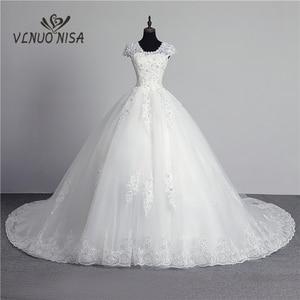 Image 1 - 100% foto real em estoque moda laço flor querida fora do branco sexy vestido de casamento muçulmano para noivas vintage applique lantejoulas