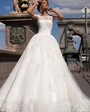 Elegant Off the Shoulder Lace Appliqued Wedding Dresses Turkey Short Sleeves Sheer Back Ball Gown Bridal Gown Vestido De Noiva