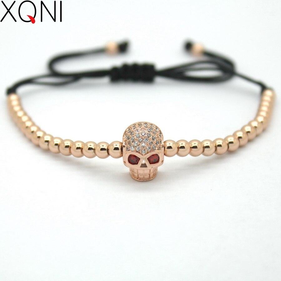 b81554f0a7ec Xqni marca enlace Rose oro color Strand Pulseras con encanto joyería de  moda mini cráneo CZ braiding macrame Cuentas mujeres pulseras