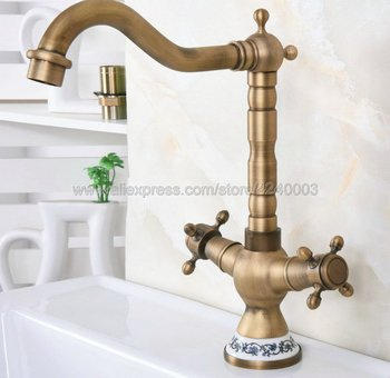цена на Basin Faucets Antique Bronze Brass Bathroom Sink Faucet 360 Degree Swivel Dual Handle Kitchen Wash basin Mixer Taps Knf602