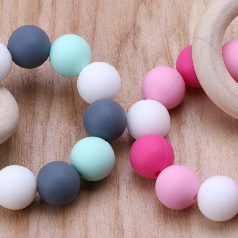 Купить с кэшбэком Baby Nursing Bracelets Wooden Teether Silicone Chew Beads Teething Rattles Toys Teether Montessori Bracelets