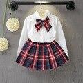 Primavera outono novo estilo de moda roupas da menina arco branco longo conjunto de roupas crianças roupas manga comprida blusa e saia xadrez vermelha conjunto