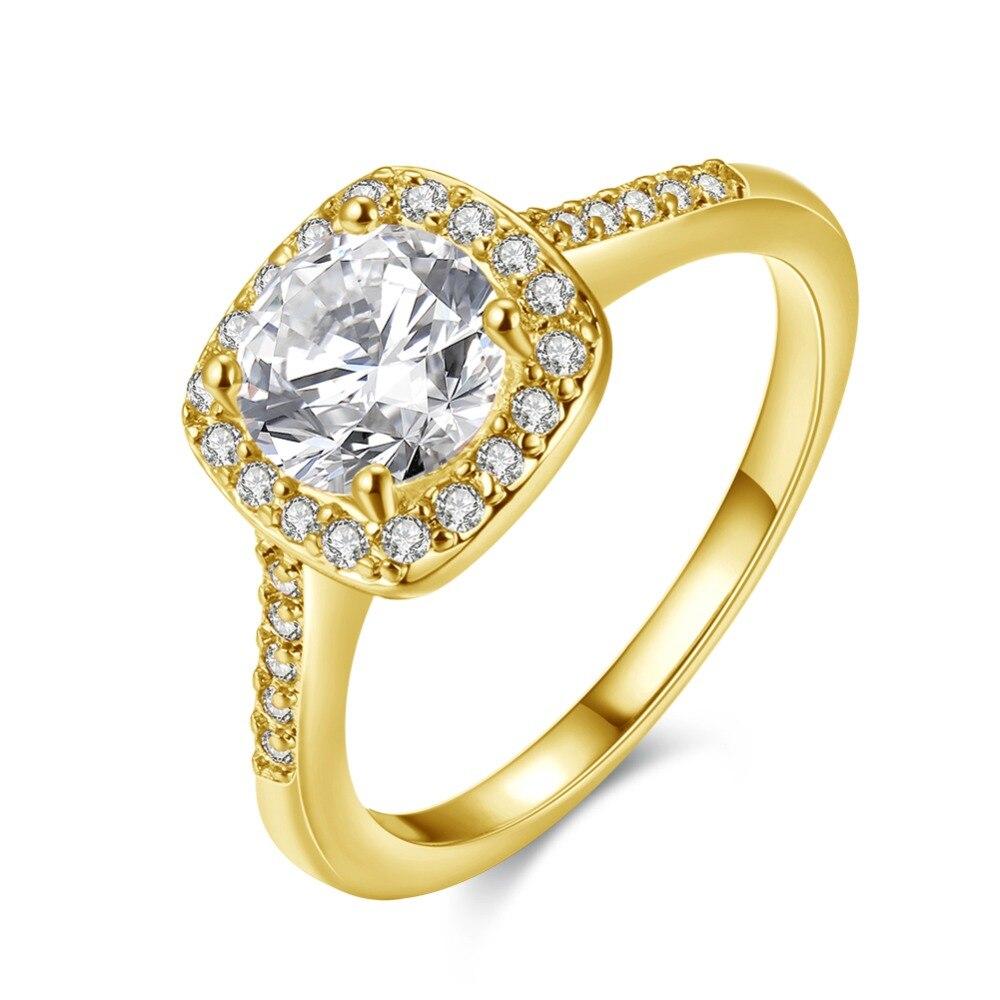 Купить женское кольцо с фианитом золотистое