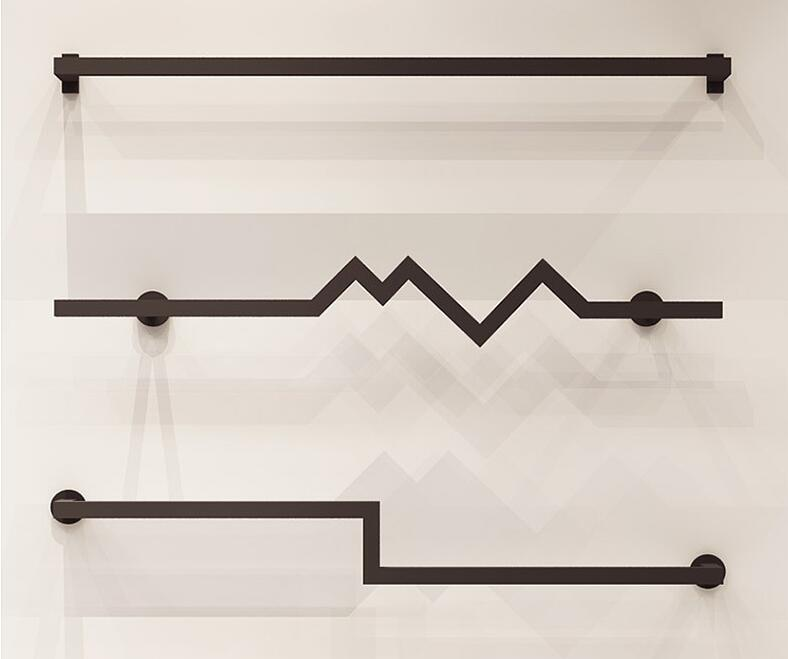 Clothing store display rack wall hanging mens and womens clothing poles clothes