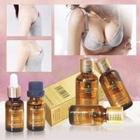 Free Shipping Breast Enhance Essential Oil New Body Massage Essential Oil New Beauty Products 2014