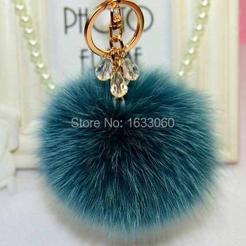 10 cm Pom Pom Fluffy Stor ægte ægte rævpels nøgleringe til rygsæk pels kugle nøglekæde vedhængspose charme kvinder taske tilbehør