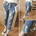 Отверстие джинсы 2016 плюс размер джинсы женские женщин 200jin вертикальная полоса лодыжки длина брюки случайные гарем брюки Девять очков джинсы