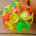 Emisor de estante bola pegajosa pelota de cricket de succión del lechón LED luminoso de juguete para niños