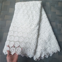 Factory offers latest cord lace fabric 2018High quality African lace with stones and beads lace in White for Party DressesUK105