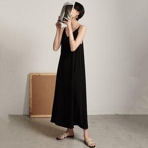 Image 2 - EAM robe longue à caractère féminin, nouveauté printemps/été, col en v, sans manches, Bandage croisé, dos nu, ample, à la mode, JW174