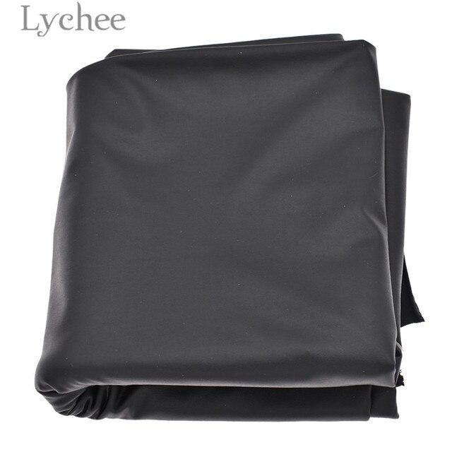 b2663ecd5 Lychee puro negro elástico de cuero sintético de tela de cuero sintético  elástico para falda pantalones DIY Material de costura para prendas de ...